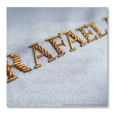 Personalized regalia: Your name hand embroidered with bullion wire